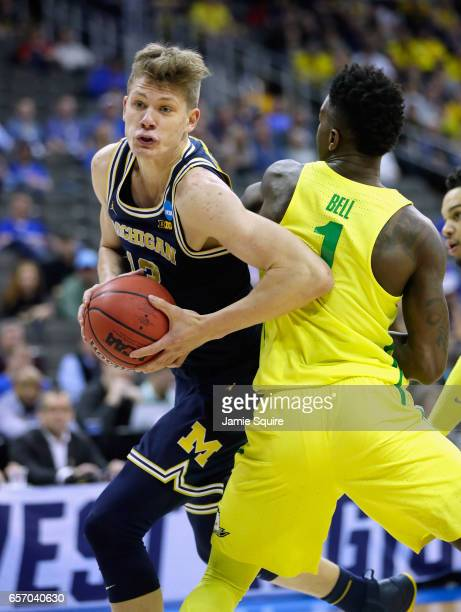 Moritz Wagner of the Michigan Wolverines handles the ball against Jordan Bell of the Oregon Ducks in the first half during the 2017 NCAA Men's...