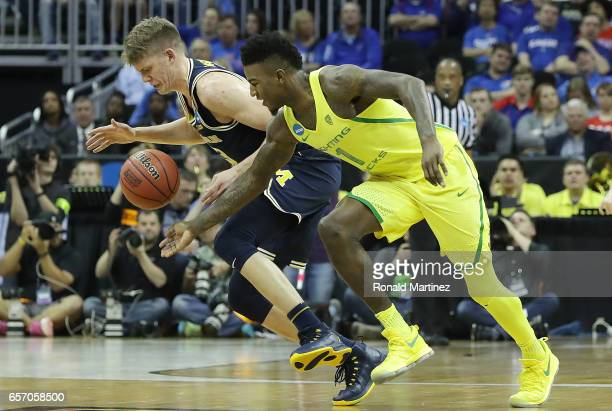 Moritz Wagner of the Michigan Wolverines is defended by Jordan Bell of the Oregon Ducks during the 2017 NCAA Men's Basketball Tournament Midwest...