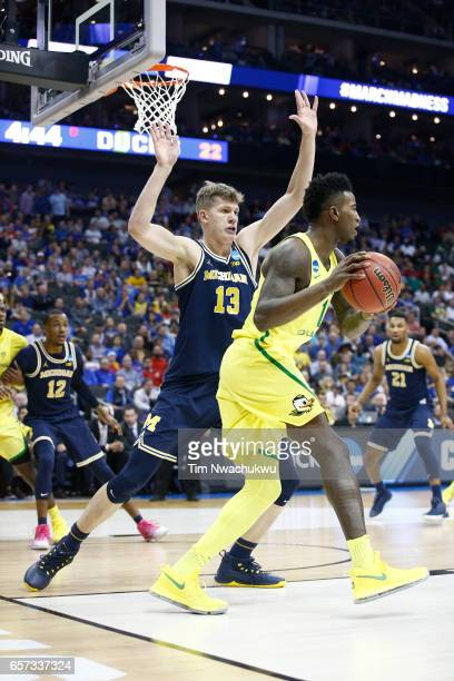Moritz Wagner of the Michigan Wolverines posts up to Jordan Bell of the Oregon Ducks during the 2017 NCAA Men's Basketball Tournament held at Sprint...