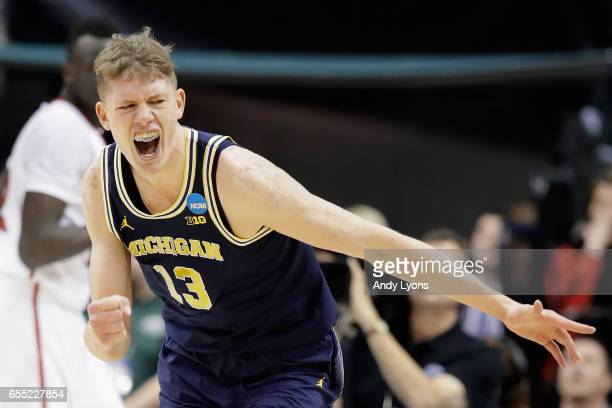 Moritz Wagner of the Michigan Wolverines reacts against the Louisville Cardinals in the first half during the second round of the 2017 NCAA Men's...
