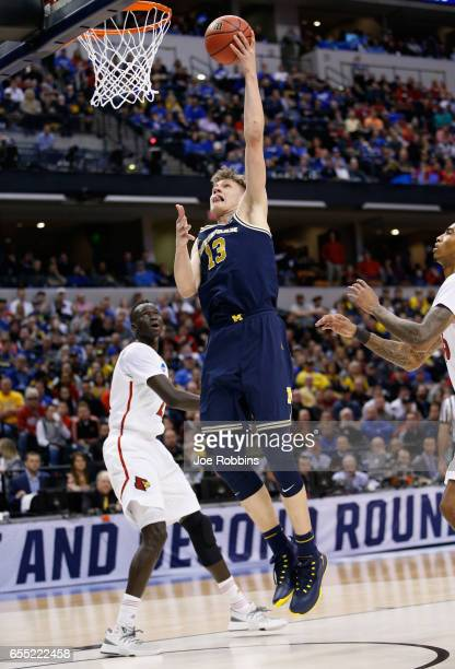 Moritz Wagner of the Michigan Wolverines shoots against the Louisville Cardinals in the first half during the second round of the 2017 NCAA Men's...