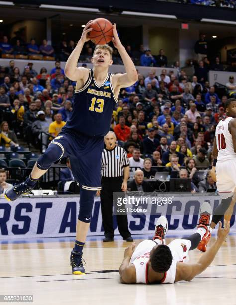 Moritz Wagner of the Michigan Wolverines shoots agianst the Louisville Cardinals in the first half during the second round of the 2017 NCAA Men's...