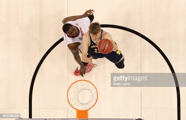 Moritz Wagner of the Michigan Wolverines shoots the ball against the Louisville Cardinals during the second round of the NCAA Basketball Tournament...