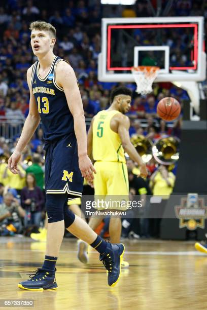 Moritz Wagner of the Michigan Wolverines walks off the court at the end of the first half during the 2017 NCAA Men's Basketball Tournament held at...