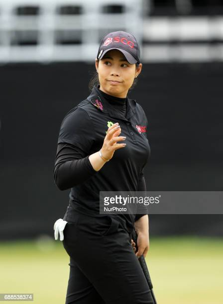 Moriya Jutanugarn of Thailand acknowledge the crowd after finishing the first round of the LPGA Volvik Championship at Travis Pointe Country Club Ann...