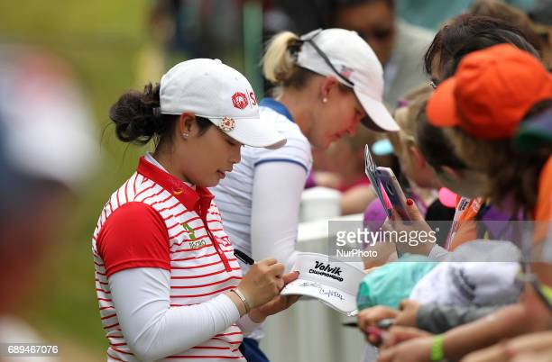 Moriya Jutanugarn of Thailand gives some autograp after finishing the final round of the LPGA Volvik Championship at Travis Pointe Country Club Ann...