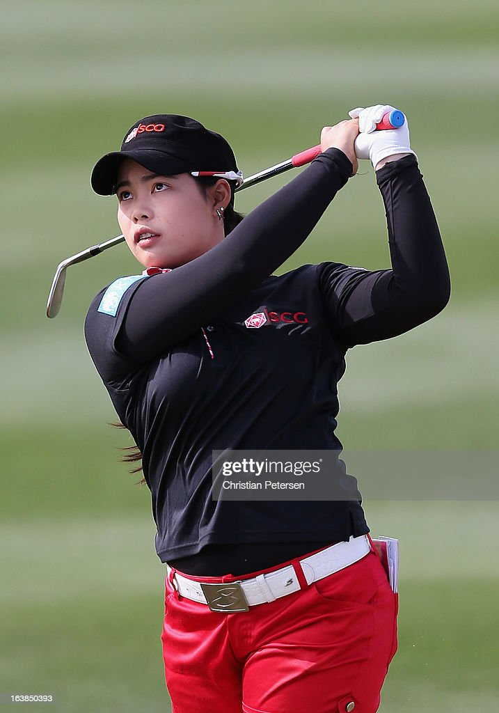 Moriya Jutanugarn of Thailand hits her second shot on the first hole during the third round of the RR Donnelley LPGA Founders Cup at Wildfire Golf Club on March 16, 2013 in Phoenix, Arizona.