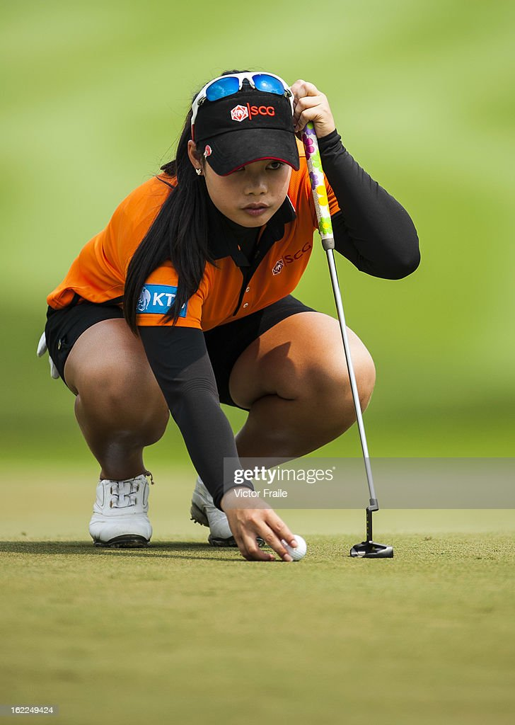 Moriya Jutanugarn of Thailand lines up a putt on the 1st green during day one of the 2013 Honda LPGA Thailand at Siam Country Club on February 21, 2013 in Chon Buri, Thailand.