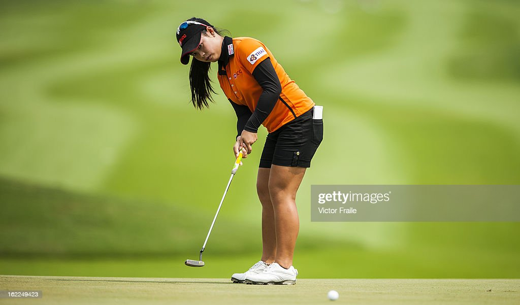 Moriya Jutanugarn of Thailand putts on the 1st green during day one of the 2013 Honda LPGA Thailand at Siam Country Club on February 21, 2013 in Chon Buri, Thailand.