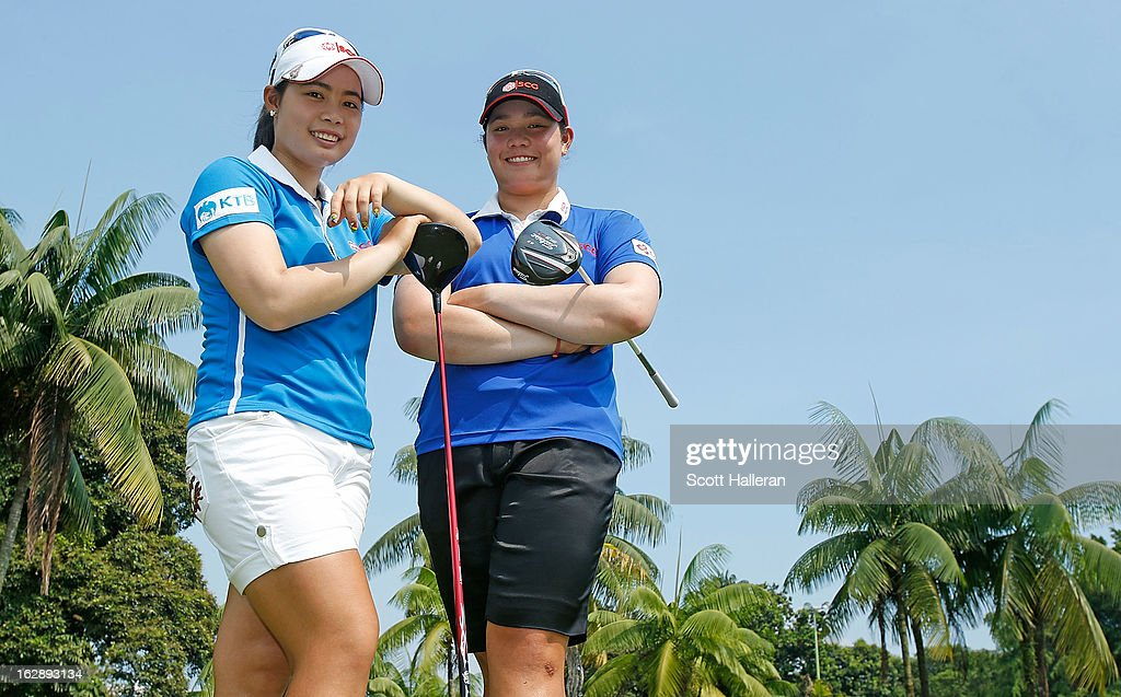 Moriya Jutanugarn (L) poses with her sister Ariya after the second round of the HSBC Women's Champions at the Sentosa Golf Club on March 1, 2013 in Singapore, Singapore.