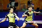 Morizono Masataka and Oshima Yuya of Japan compete against Xu Xin and Zhang Jike of China during their Men's Doubles Quarterfinal Match on day five...