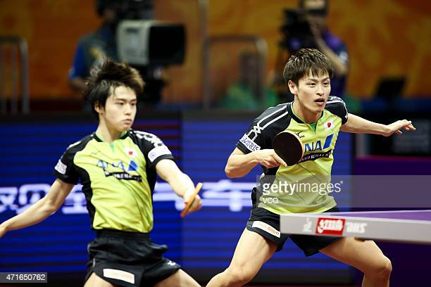 Morizono Masataka and Oshima Yuya of Japan compete against Xu Xin and Zhang Jike of China during their Men's Doubles Quarterfinal Match on day five...