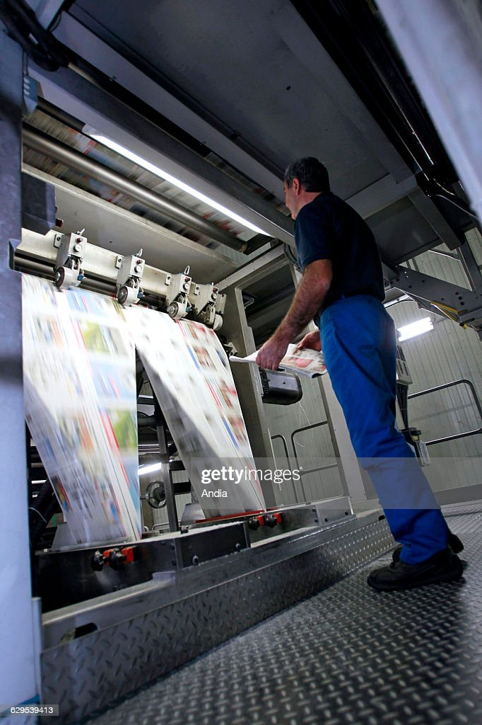 Morlaix Headquaters of 'Le Telegramme' Worker in front of the rotary press at night printing the daily newspaper