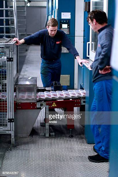 Morlaix Headquaters of 'Le Telegramme' Workers in front of the rotary press at night printing the daily newspaper