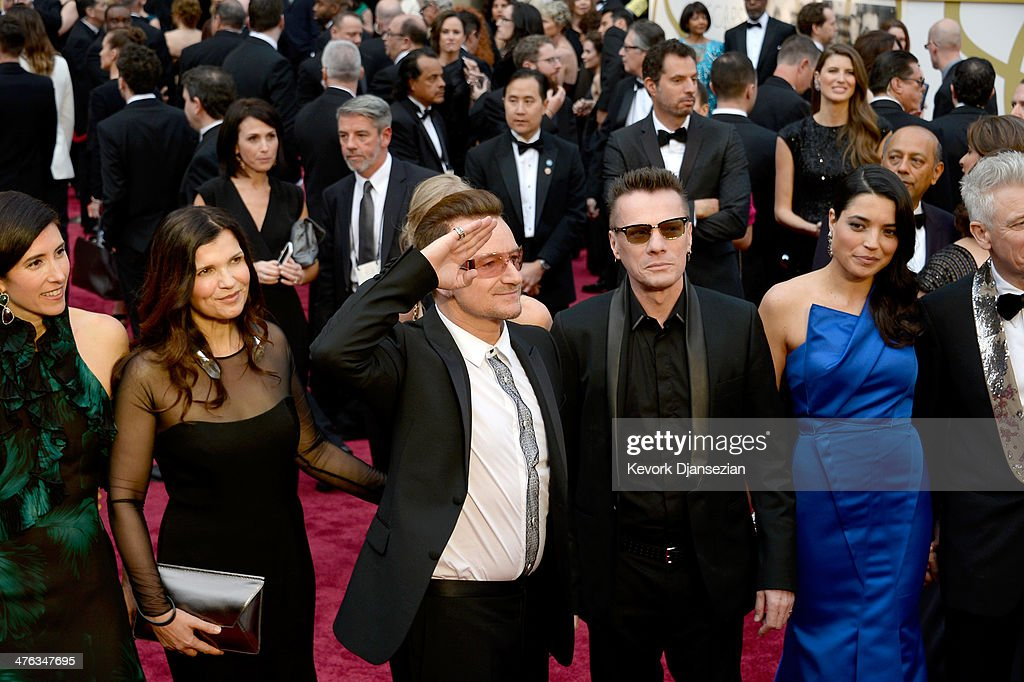 Morleigh Steinberg, Alison Hewson, singer Bono, musician Larry Mullen Jr., and Mariana Teixeira attend the Oscars held at Hollywood & Highland Center on March 2, 2014 in Hollywood, California.