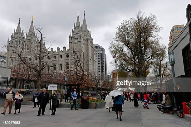 Mormon conference goers walk around Temple Square at the 184th annual general conference of The Church of Jesus Christ of Latter Day Saints Mormons...