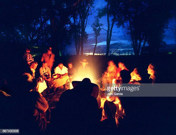 LSmormonfire0604AAG––Mormon Trail participants enjoy an evening together with an old–fashioned campfire in Bridgeport Nebraska While most are asleep...