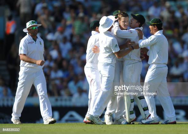 Morne Morkel celebrates with team mates during the Investec first test match at the Kia Oval London