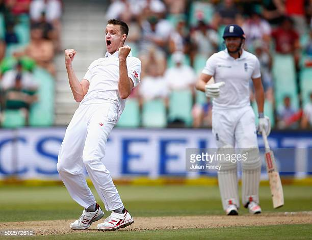 Morne Morkel of South Africa celebrates taking the wicket of Chris Woakes of England during day two of the 1st Test between South Africa and England...