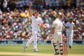 Morne Morkel of South Africa celebrates taking the wicket of Matthew Wade of Australia during day two of the Second Test match between Australia and...