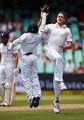 Morne Morkel of South Africa celebrates taking the wicket of Moeen Ali of England during day two of the 1st Test between South Africa and England at...