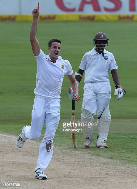 Morne Morkel of South Africa celebrates the wicket of Marlon Samuels for 33 runs during day 3 of the 1st Test match between South Africa and West...