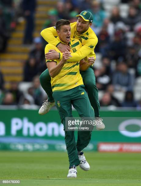 Morne Morkel of South Africa celebrates with David Miller after dismissing Fakhar Zaman of Pakistan during the ICC Champions Trophy match between...