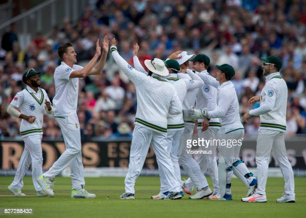 Morne Morkel of South Africa is congratulated by his team mates after claiming the wicket of Tom Westley during the third day of the fourth test...