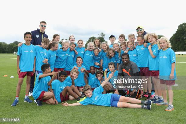 Morne Morkel of South Africa Muttiah Muralitharan and Farhaan Behardien of South Africa pose for the camera with kuds from a local school during the...