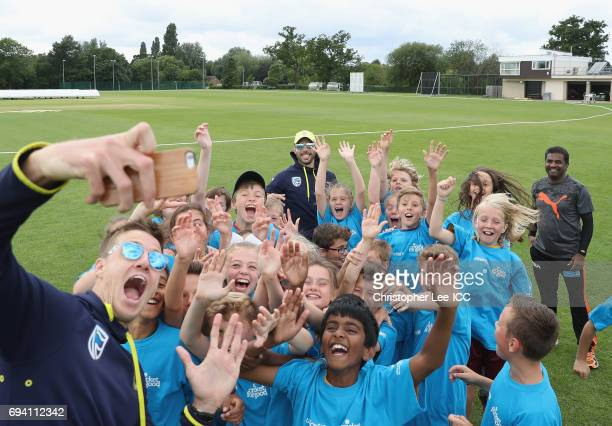 Morne Morkel of South Africa takes a selfie with Muttiah Muralitharan Farhaan Behardien and kids from a local school during the ICC Cricket For Good...