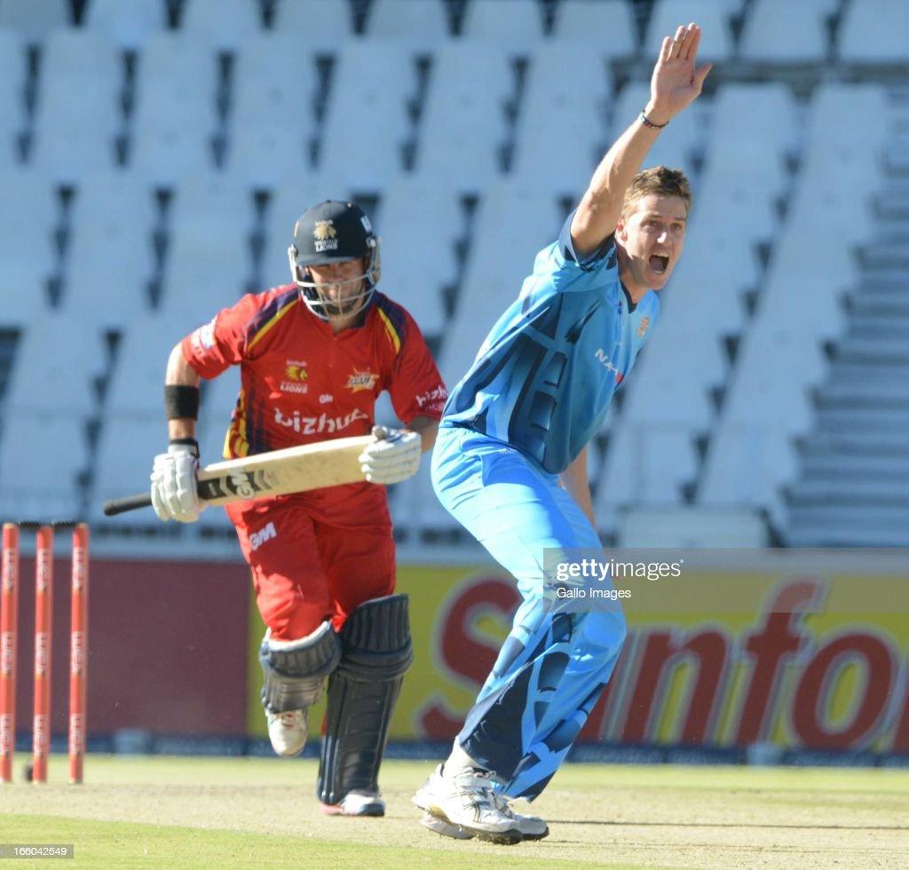 <a gi-track='captionPersonalityLinkClicked' href=/galleries/search?phrase=Morne+Morkel&family=editorial&specificpeople=4064354 ng-click='$event.stopPropagation()'>Morne Morkel</a> of the Nashua Titans celebrates the wicket of Neil McKenzie during the 2013 RAM Slam T20 Challenge Final between Bizhub Highveld Lions and Nashua Titans at Bidvets Wanderers Stadium on April 07, 2013 in Johannesburg, South Africa.