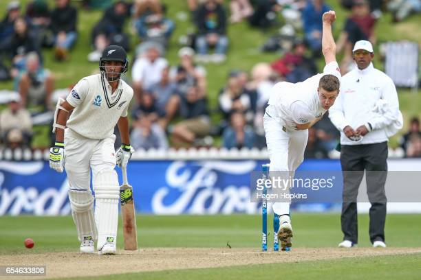 Morne Morkell of South Africa bowls while Jeet Raval of New Zealand and umpire Kumar Dharmasena of Sri Lanka look on during day three of the test...