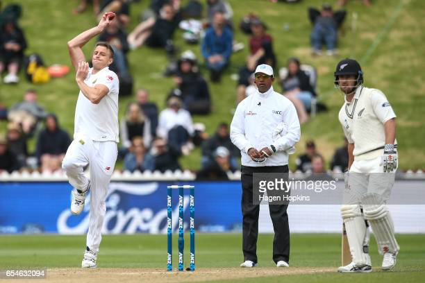 Morne Morkell of South Africa bowls while umpire Kumar Dharmasena of Sri Lanka and Neil Broom of New Zealand look on during day three of the test...