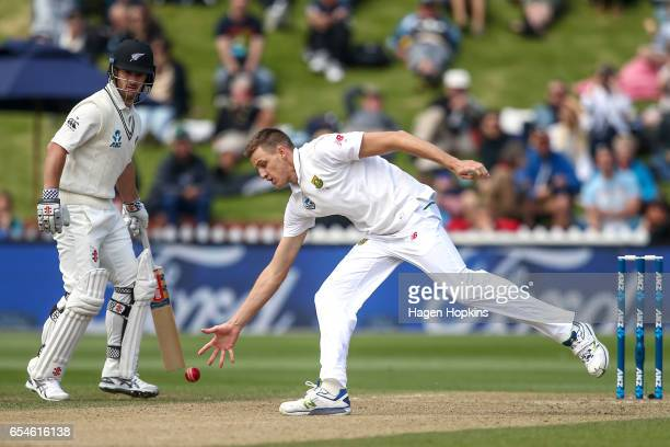 Morne Morkell of South Africa fields off his own bowling while Neil Broom of New Zealand looks on during day three of the test match between New...