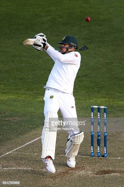 Morne Morkell of South Africa is struck in the helmet by a delivery from Tim Southee of New Zealand during day two of the test match between New...