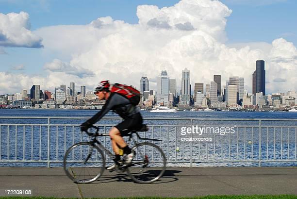 morning bike ride against city skyline