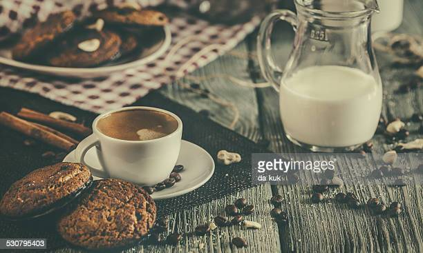 Morning breakfast with coffee, cookies and milk