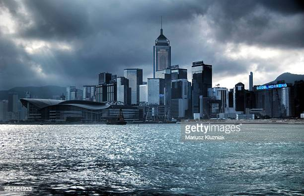 Morning clouds and sun rays over Hong Kong harbour
