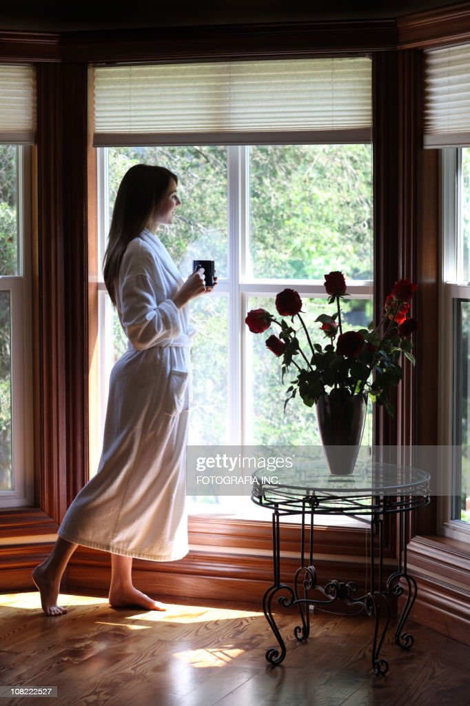 Morning coffee by the window : Stock Photo