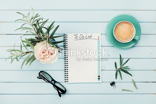 Morning coffee cup, notebook, rose flower. Planning and design concept.