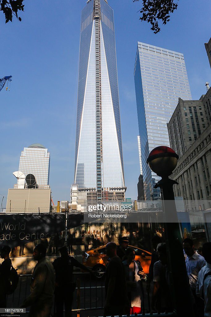 Morning commuters and tourists walk along one block from the World Trade Center September 11, 2013 in the Manhattan borough of New York.