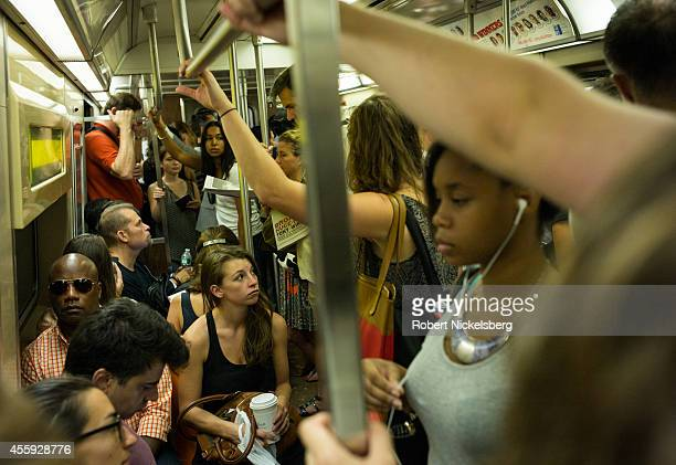 Morning commuters ride the subway September 5 2014 in the Manhattan borough of New York