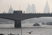 Morning commuters walk across Waterloo Bridge through smog on April 10 2015 in London England Air pollution and smog has blanketed much of central...