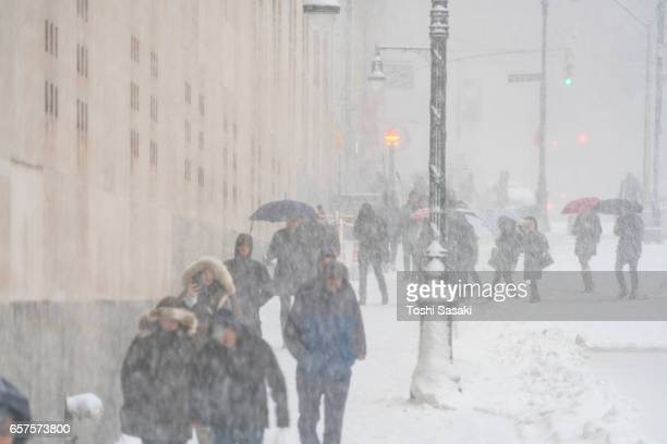 Morning commuters walk on Snowy Street during the snowstorm at Lower Manhattan on Feb. 09 2017.