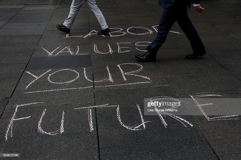 Morning commuters walk past a Labor message on the ground during a Medicare Rally at Martin Place on July 1, 2016 in Sydney, Australia.Bill Shorten is campaigning heavily on Medicare, promising to make sure it isn't privatised if the Labor Party wins the Federal Election on July 2.