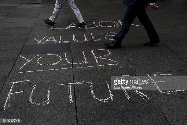 Morning commuters walk past a Labor message on the ground during a Medicare Rally at Martin Place on July 1 2016 in Sydney AustraliaBill Shorten is...