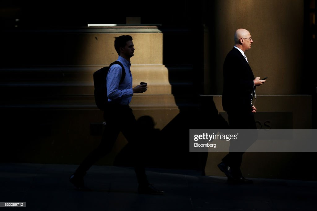 Morning commuters walk through Martin Place in Sydney, Australia, on Thursday, Aug. 17, 2017. Australian employers added more jobs than forecast in July, underscoring the central banks confidence in an improving labor market. Photographer: Brendon Thorne/Bloomberg via Getty Images
