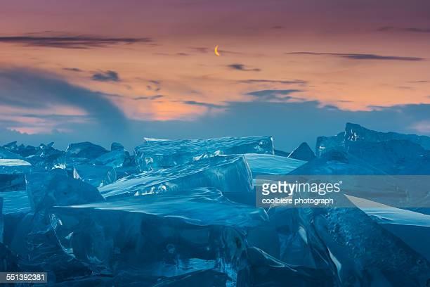 Morning crescent moon at frozen lake