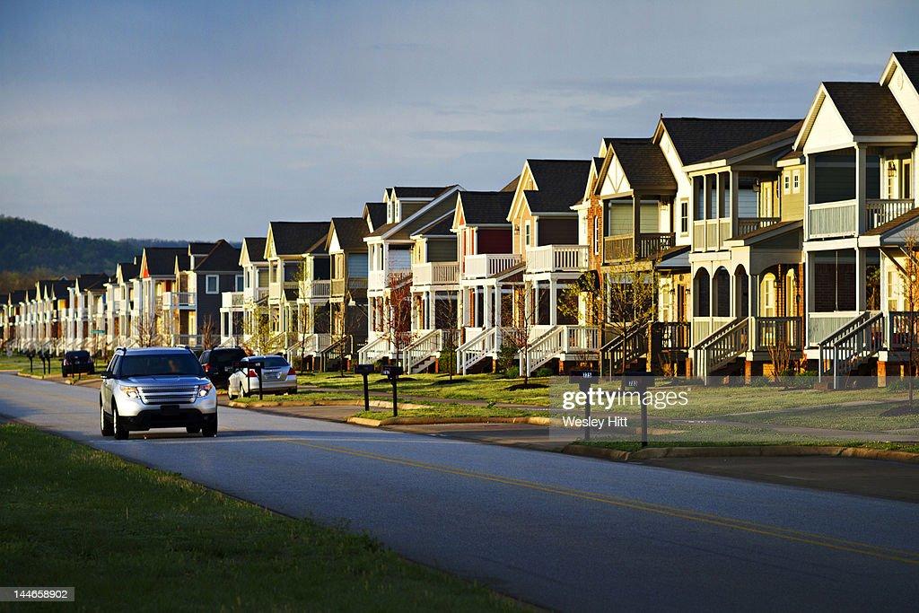 Morning drive to work through suburbia : Stock Photo