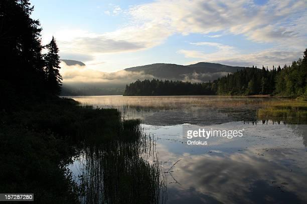 Morning Fog on Lake at Sunrise in Summer